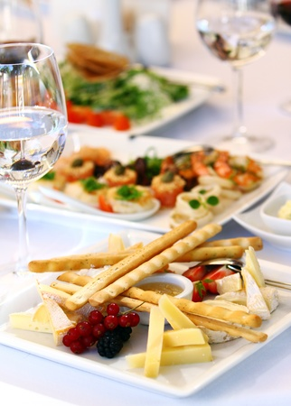 holiday catering: Different tasty snacks for wine on luxury banquet table Stock Photo