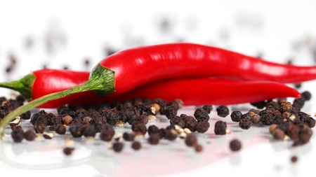 Red chilli pepper over white background photo
