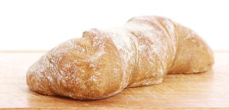 Closeup of fresh bread on a chopping board photo