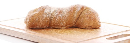 Closeup of fresh bread on a chopping board photo