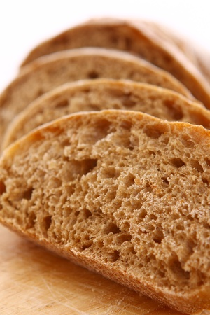 Closeup of sliced bread on a chopping board photo