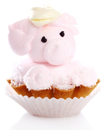 Fresh and tasty cake in the form of pig isolated on white photo