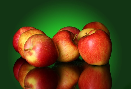 Fresh and tasty apples against green gradient photo
