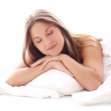 Young and Beautiful woman sleeping in bed photo