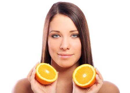 Beautiful woman with orange in hands against white background Stock Photo - 10787245