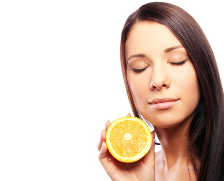 Beautiful woman with orange in hands against white background Stock Photo - 10755998