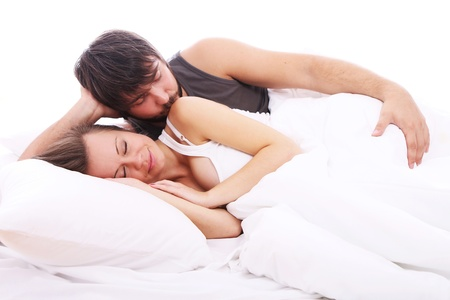 Guy is kissing her girlfriend shoulder in bed Stock Photo - 10787291