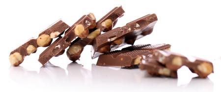 deliciously: Pieces of milk chocolate with nuts against white background