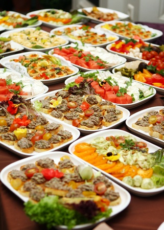 food buffet: Banquet table with different snacks Stock Photo