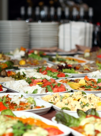 cater: Banquet table with different snacks Stock Photo