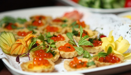 Close up of tarlet with red caviar  photo
