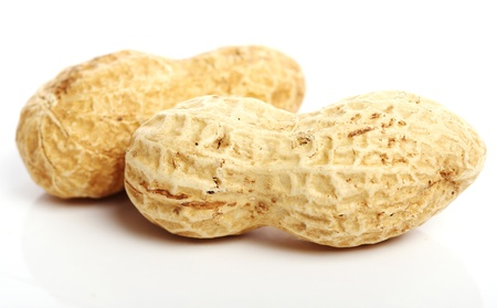 nut shell: Close up of fresh peanuts against white background