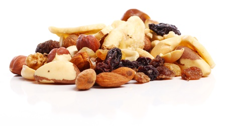 Different dried fruits against white background photo