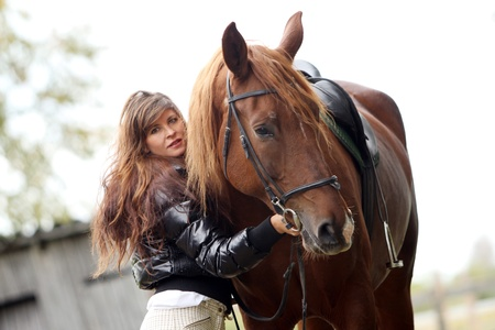 Woman and her beautiful  brown horse Stock Photo - 10952765