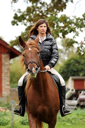 Woman and her beautiful  brown horse photo