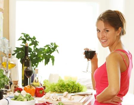 Woman drinking wine on the kitchen Stock Photo - 10952717