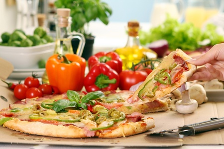 Fresh and tasty pizza on kitchen table photo