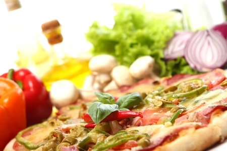 gourmet pizza: Fresh and tasty pizza on kitchen table