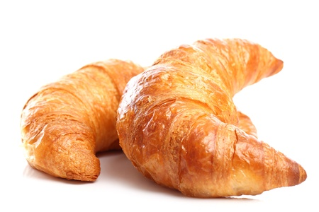 croissant: Fresh and tasty croissant over white background