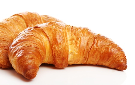 continental: Fresh and tasty croissant over white background