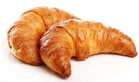 croissant: Fresh and tasty croissant over white background
