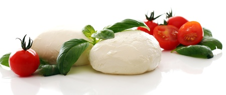 Fresh and tasty tomatoes, basil and mozzarella photo