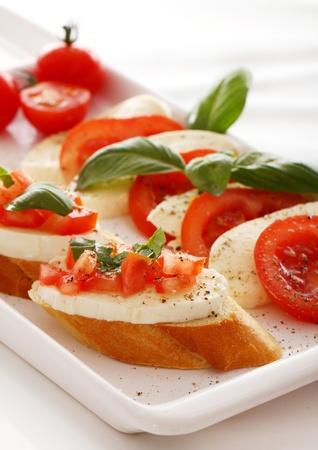 Fresh and tasty bruschetta over white background photo