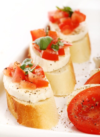 Fresh and tasty bruschetta over white background Stock Photo