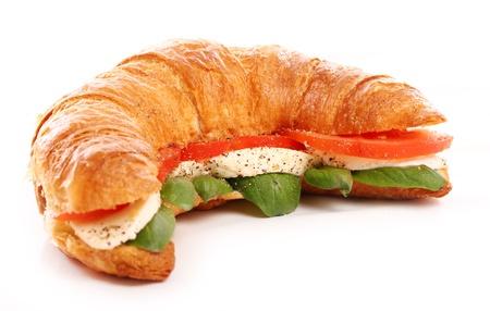 Croissant with basil, tomato and mozzarella over white background photo