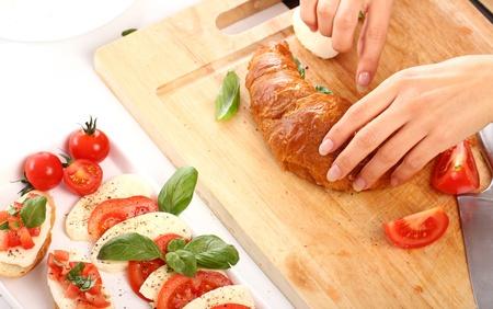 Woman prepare  food on wooden board photo