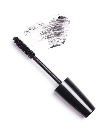 Brush of black mascara for eyes against white background Stock Photo - 10883283