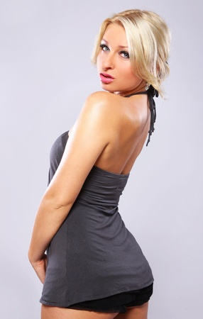Portrait of Sexy blonde in gray dress  photo
