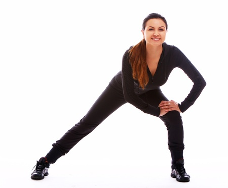 Beautiful and happy woman doing fitness exercises isolated over white Stock Photo - 10952682