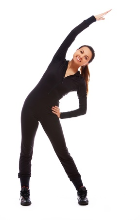 Beautiful and happy woman doing fitness exercises isolated over white Stock Photo - 10952694