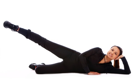 Beautiful and happy woman doing fitness exercises isolated over white Stock Photo - 10952689