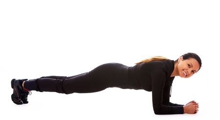pushup: Beautiful and happy woman doing fitness exercises isolated over white