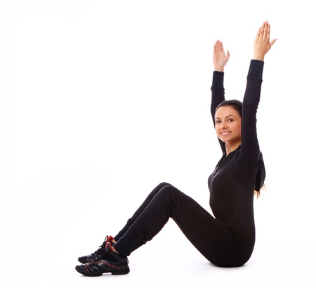 Beautiful and happy woman doing fitness exercises isolated over white Stock Photo - 10952680