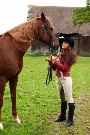 Woman and her beautiful  brown horse Stock Photo - 10952873