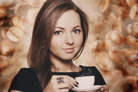 Beautiful woman with cup of hot coffee against grunge background photo