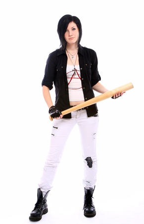 Young punk girl with baseball bat against white background photo