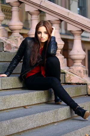 Young and Beautiful brunette on the stairs photo