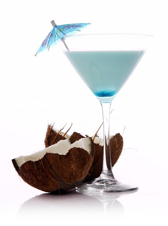 Fresh coconut cocktail over white background