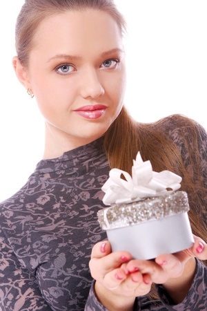 Young and beautiful woman with a small gift box in hands  photo