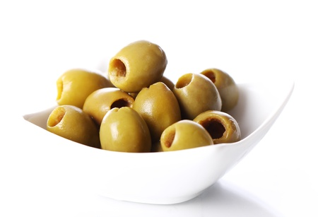 Green olives over white background Stock Photo