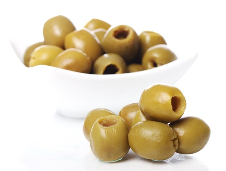 Green olives over white background photo