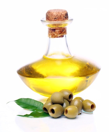 extra: Green olives in oil over white background Stock Photo