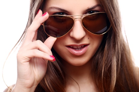 Portrait of young and beautiful woman  in sunglasses photo