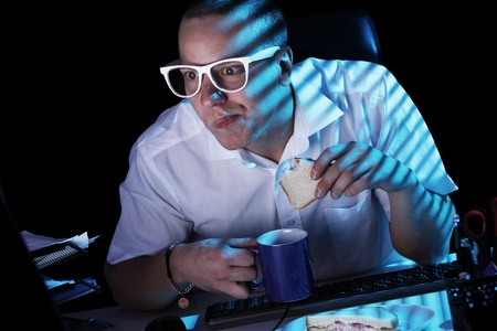 Funny nerd in glasses surfs internet at night time Stock Photo - 11929781