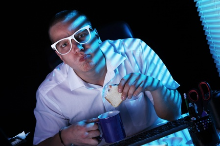 Funny nerd in glasses surfs internet at night time Stock Photo - 11929786