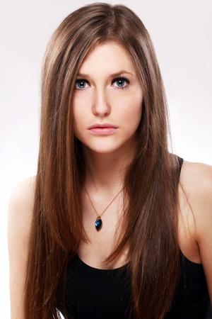 Young and Beautiful woman with long hair photo